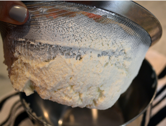 Rubbing the ricotta through a fine screen to create a finer texture | labellasorella.com