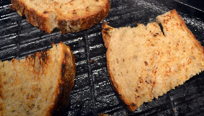 Toasting the country bread for Bruschetta with Tomato, Mozzarella & Anchovy | labellasorella.com
