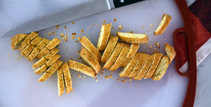Slicing the once baked Anise Biscotti | labellasorella.com