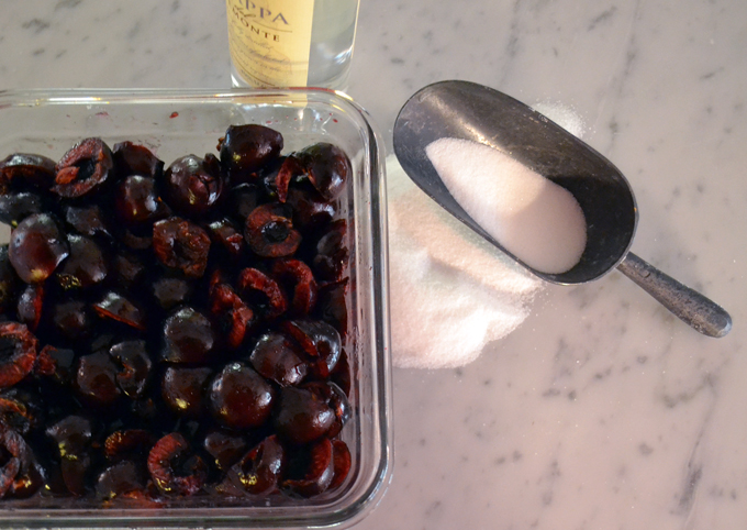 Macerating the cherries in a bit of sugar and Grappa | labellasorella.com