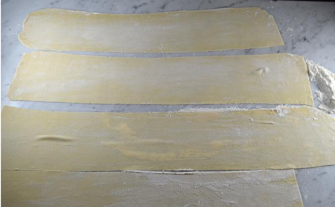 Thin sheets of pasta await the filling   labellasorella.com