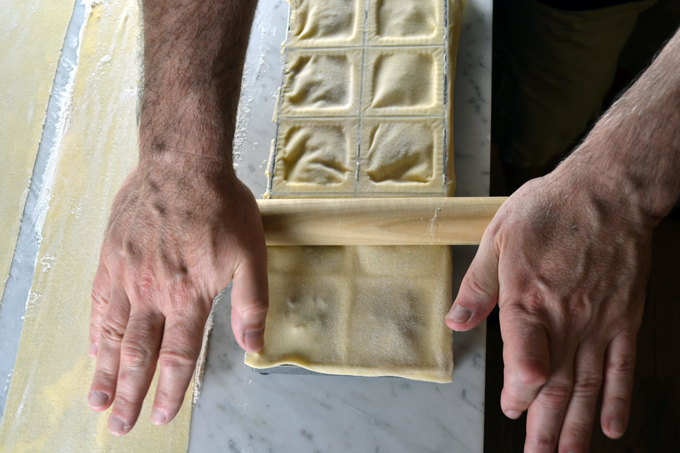 Completing the ravioli with an old fashioned rolling pin | labellasorella.com