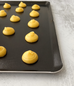 Choux Pastry piped onto baking sheet