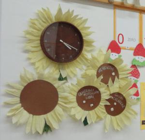 Trasforma l'orologio e il cartellone degli incarichi in un angolo di giardino!