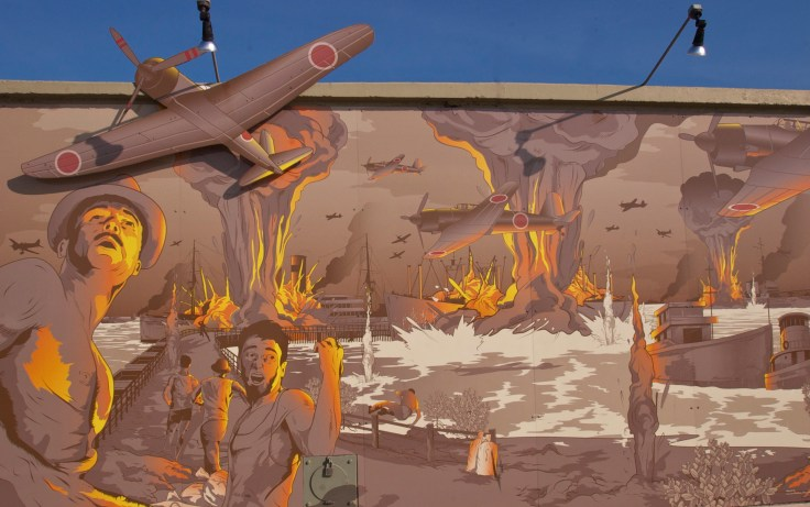 "Darwin Harbour mural ""pays tribute to all the waterside workers and seafarers who lost their lives at stokes hill wharf"" on the first bombing of Darwin, 19 February 1942 (Source: Inside History)."