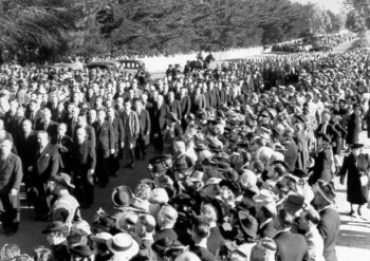 Left: Trade Unionists marching in John Curtin's funeral procession. Curtin University Library. Right: The PM lying in State. 110359 Australian War Memorial.