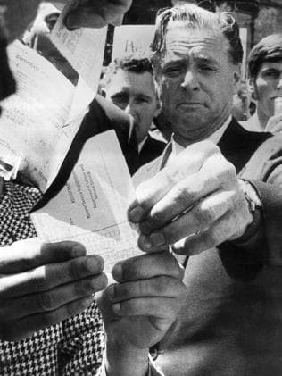 'Dr Jim Cairns burns a draft card in the Melbourne Civic Square during a November 1969 protest. Picture: HWT Library.'