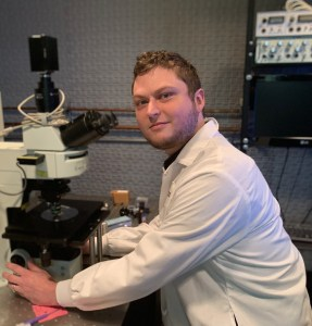 Keith Baugh at the microscope