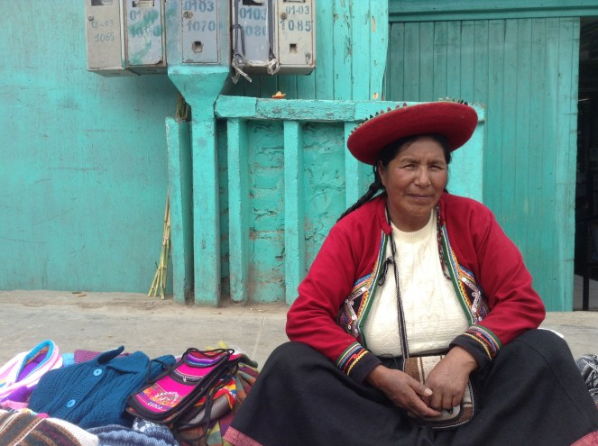 I bought my wallet from this woman and she gladly granted me permission to photograph her.