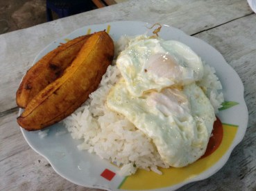Plantains, fried eggs, and rice for breakfast