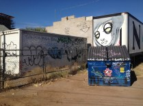 This alley way is home to several works of street art as well as one of the first dumpster pieces we found.