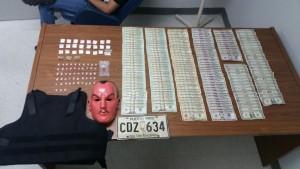 Droga y dinero confiscado por las autoridades en una residencial del barrio Quemado de Mayaguez (Suministrada Policía).
