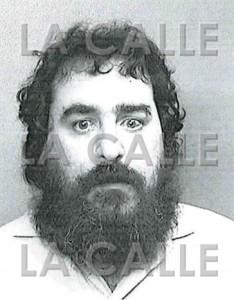 """Foto de la ficha de Luis G. Rivera Seijo, alias """"El Manco"""" (Suministrada Policía)."""
