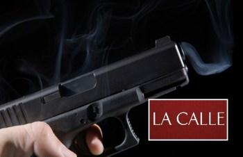 pistola disparada logo