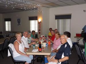 A table of happy La Casa residents enjoying the July dance.