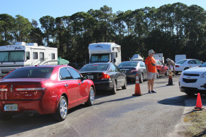 Paul Reed directs traffic as the cars enter the RV Compound to be washed.