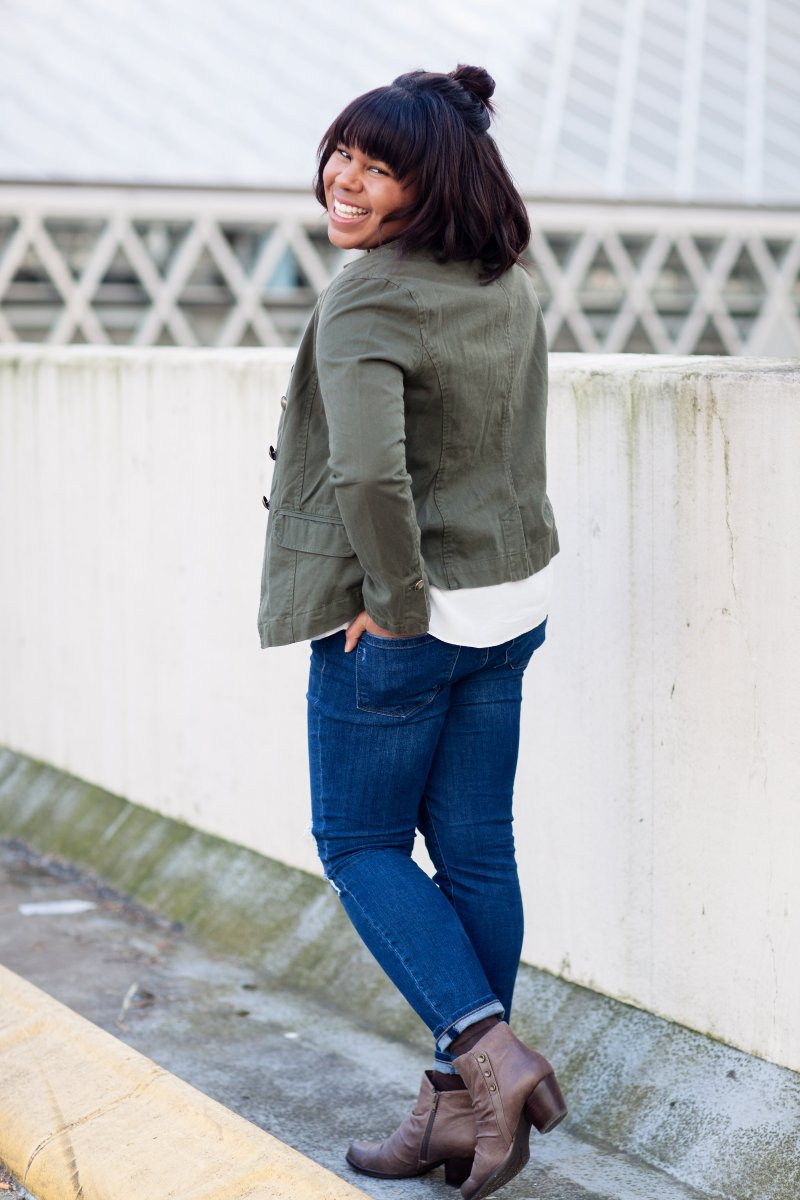 Military blazer with ruffle blouse and denim.
