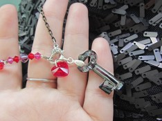 "After the charms have been layered, an 8"" crystal insert strand (pomegranate, bold style) is connected to the clasp."