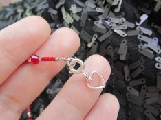 "Dreaming of a matching bracelet? Your wish is my command! Attach a heart tab hook up clasp to the end of a 7"" delicate style crystal insert strand (pomegranate)."