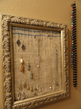 A little trip into my bathroom. Again, an old frame from mom turned into something useful. Burlap stapled into the back so earrings can hook right on the fabric.