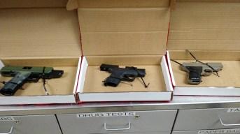 The three hand guns recovered.