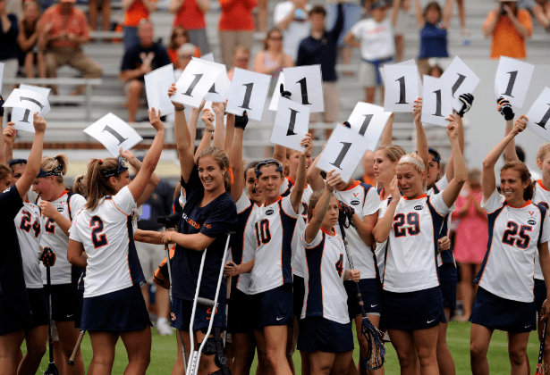 """May 16, 2010; Charlottesville, VA, USA; Players on the Virginia Cavaliers women's lacrosse team hold up signs with the number """"1"""" in memory of Yeardley Love after the first round of the NCAA women's lacrosse tournament game against the Towson Tigers at Klšckner Stadium. Virginia defeated Towson 14-12. Mandatory Credit: Rafael Suanes-US PRESSWIRE"""