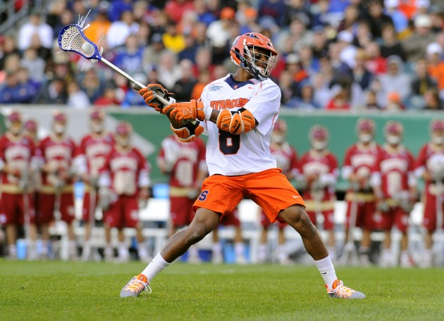 May 25, 2013; Philadelphia, PA, USA; Syracuse Orange midfielder Hakeem Lecky (8) takes a shot against the Denver Pioneers during the third quarter of the 2013 NCAA Division I Men's Lacrosse Semifinals at Lincoln Financial Field. Syracuse won the game 9-8. Mandatory Credit: Rich Barnes-USA TODAY Sports