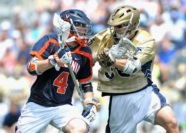 May 20, 2012; Chester, PA USA; Virginia Cavaliers attack Matt White (4) drives against Notre Dame Fighting Irish defender Daniel Lantz (38) during the second half of the NCAA Division I Men's Lacrosse Quarterfinals at PPL Park. The Fighting Irish won 12-10. Mandatory Credit: Eric Hartline-USA TODAY Sports