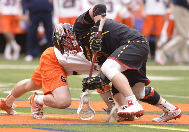 Feb 22, 2014; Syracuse, NY, USA; Maryland Terrapins midfielder Charlie Raffa (7) wins a faceoff during the second quarter of a game against the Syracuse Orange at the Carrier Dome. Mandatory Credit: Mark Konezny-USA TODAY Sports