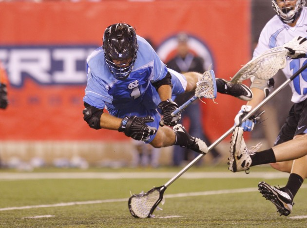 Apr 1, 2012; East Rutherford, NJ, USA; North Carolina Tar Heels attack Marcus Holman (1) scores goal against John Hopkins Blue Jays at the Big City Classic at MetLife Stadium. North Carolina Tar Heels defeat the John Hopkins Blue Jays 13-9. Mandatory Credit: Jim O'Connor-USA TODAY Sports