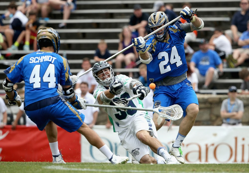 CHARLOTTE, NC - MAY 10:  Ryan Flanagan #24 of the Charlotte Hounds watches as Matt Mackrides #39 of the Chesapeake Bayhawks shoots during their game at American Legion Memorial Stadium on May 10, 2015 in Charlotte, North Carolina.  (Photo by Streeter Lecka/Getty Images)