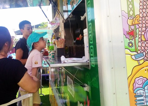 Young customers waiting for food on food truck