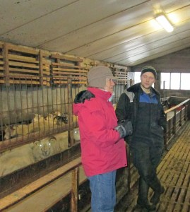 Sharon visits with a farmer about his sheep