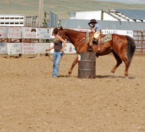 McCoy in the barrel race, with a little help from his Mom