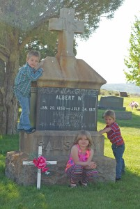 Tiaran, Maeve and Rhen with the graves of Great-great-great Grandpa A.W. and Great-great-great Grandma Anna Louise