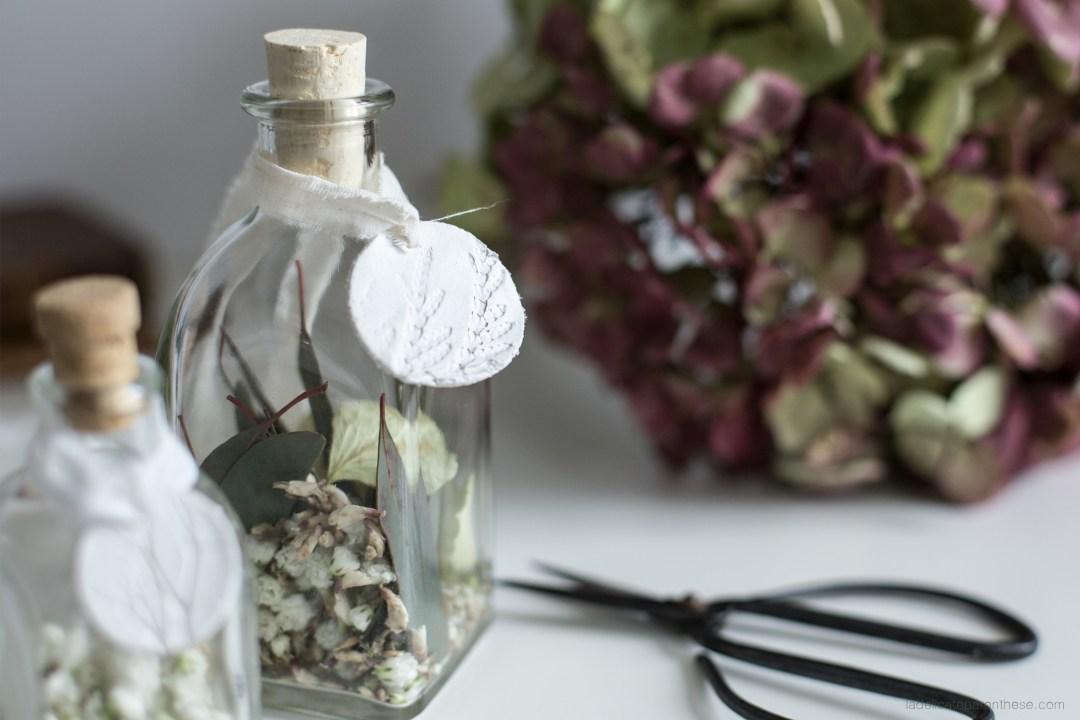 création de flacons personnalisés de médaille en céramique à offrir