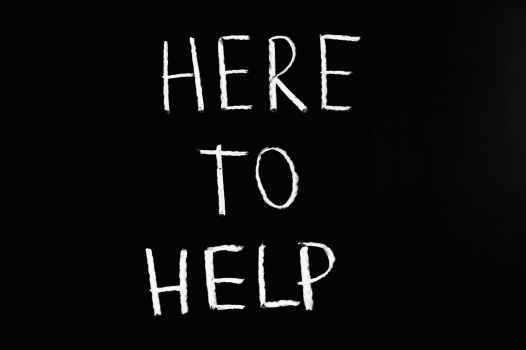 here to help lettering text on black background