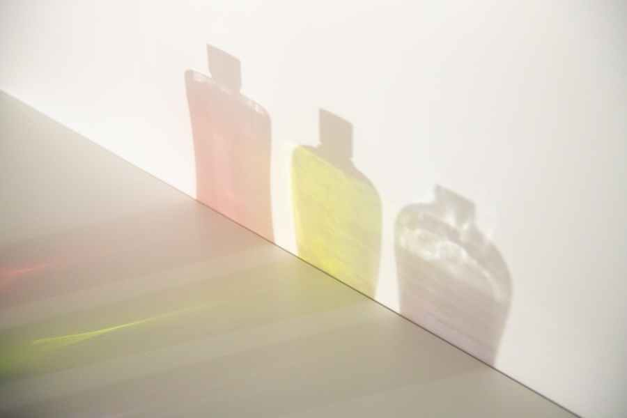 shades of bottles with gels on white wall