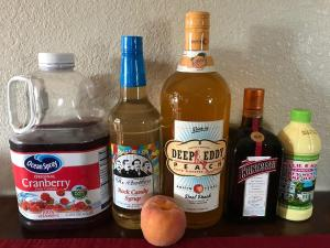 Recipe for a Peach Cosmopolitan martini cocktail. Ingredients include Deep Eddy Peach Vodka, Cointreu, Cranberry Juice, Lime Juice, and Fee Brothers Rock Candy Simple Syrup