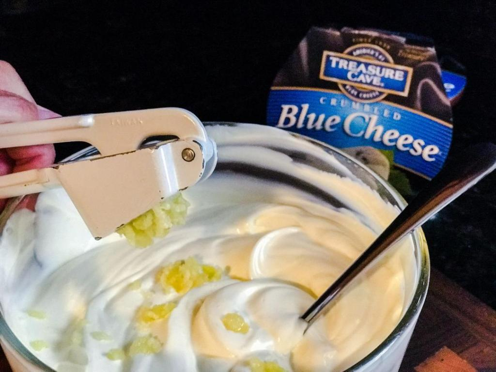 Best Ever Blue Cheese Dressing Recipe. Ingredients include blue cheese crumbles, mayo, sour cream, garlic, and lemon juice