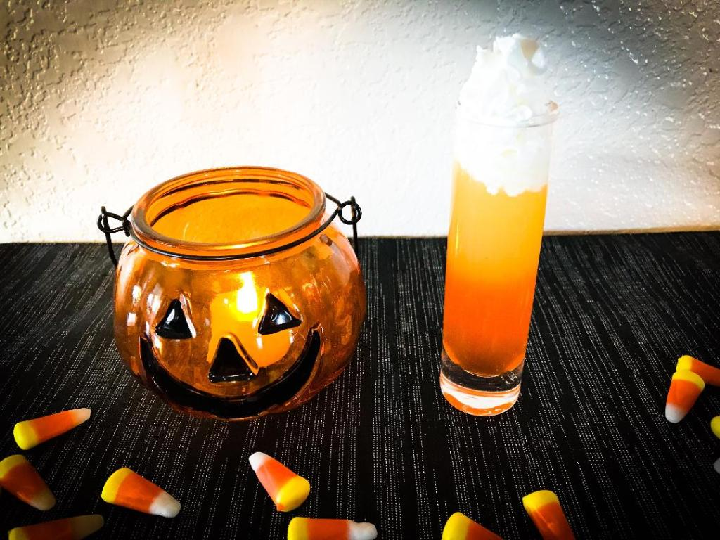 Candy corn shot made with Pinnacle Cake Vodka, candy corn, pineapple juice, and whip cream