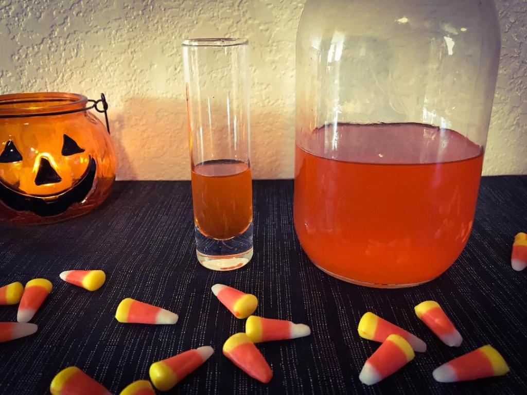 First layer of Candy Corn Shot. Making candy corn shot using Pinnacle Cake Vodka, candy corn, pineapple juice, and whip cream