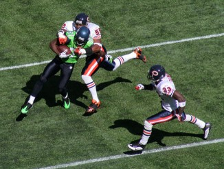Chicago Bears player tackling a Seattle Seahawks player