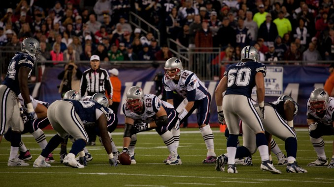 Tom Brady Quarterback for the New England Patriots takes a hike in a football game