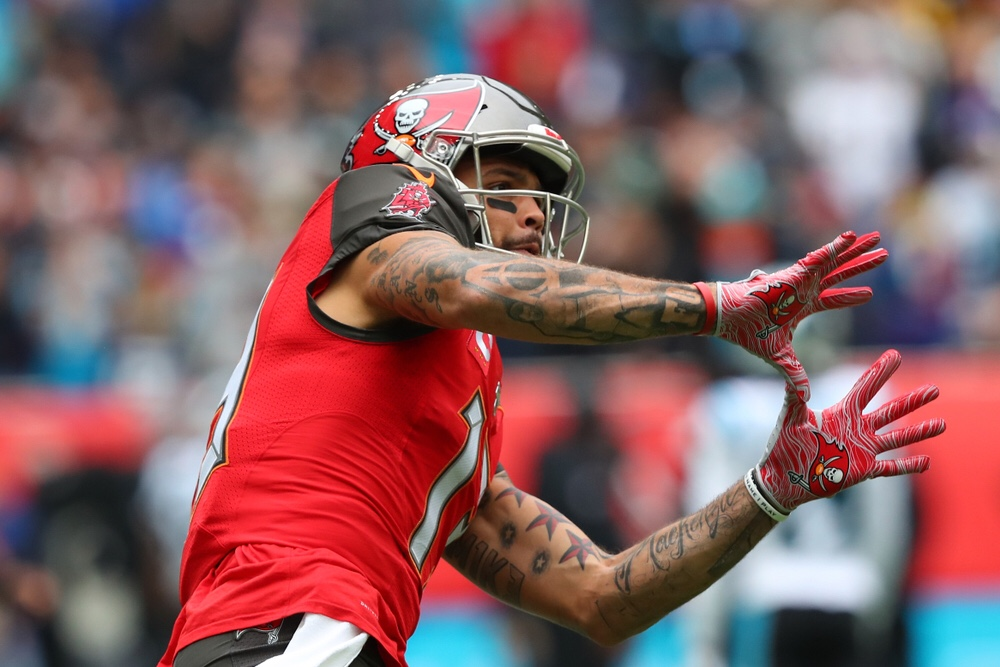 NFL Tampa Bay Buccaneers wide receiver Mike Evans getting ready to catch a pass on the football field.