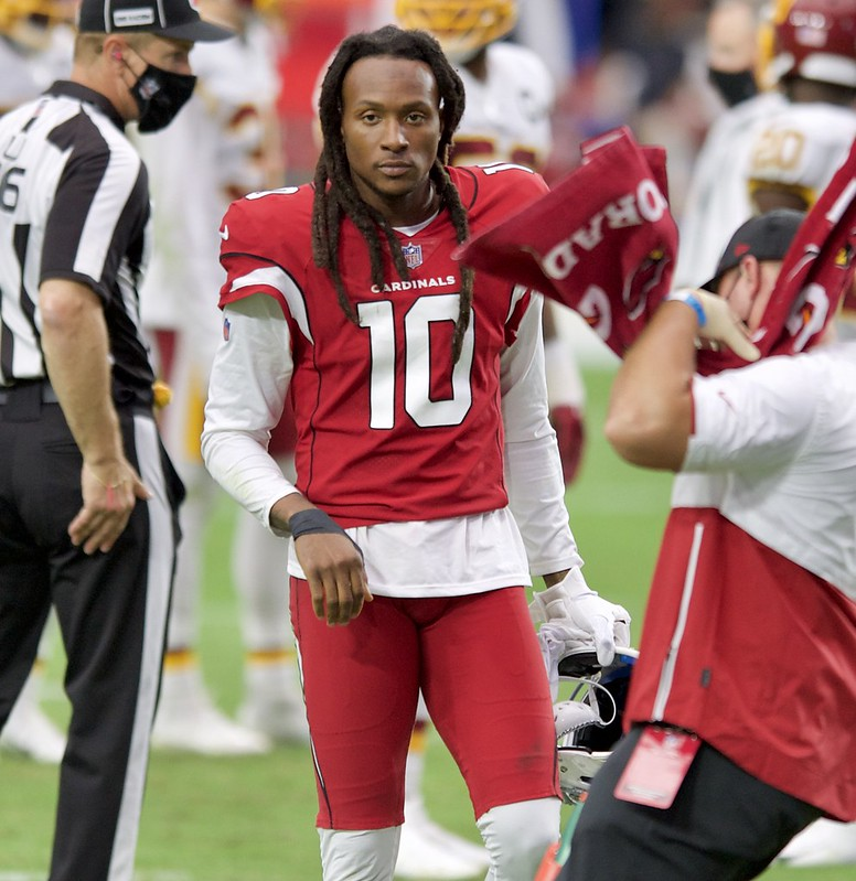 NFL Arizona Cardinals wide receiver DeAndre Hopkins in his red uniform on the football field