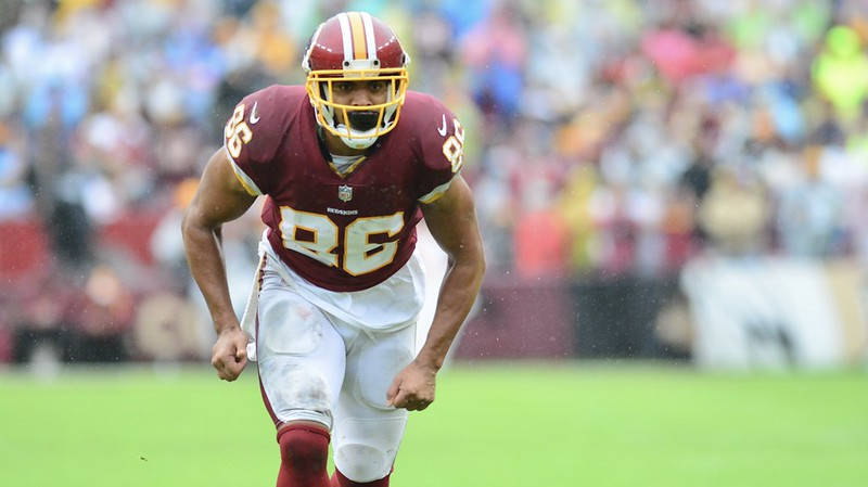 NFL tight end Jordan Reed lining up on the football field for a play