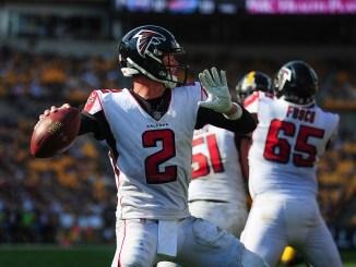 NFL Atlanta Falcons quarterback Matt Ryan getting ready to throw a pass in a football game