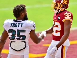 NFL Philadelphia Eagles running back Boston Scott shaking hands with Washington Football Team Danny Johnson