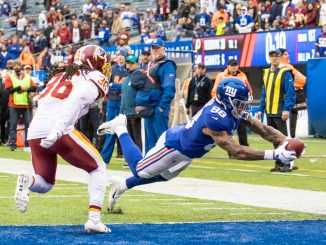 NFL New York Giants tight end Evan Ingram catching a touchdown pass in the endzone